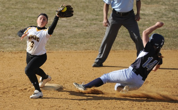 The University of Maine's Jessica Burk is forced out as UMBC's Kaitlin Olesky tags second base during sixth-inning action on Friday at Orono.