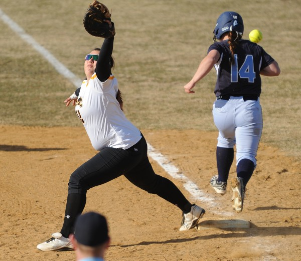 University of Maryland Baltimore County's Chelsea Bertoglio misses a throw to first as UMaine's Jessica Burk reaches on a single in the sixth inning on Friday at Orono.