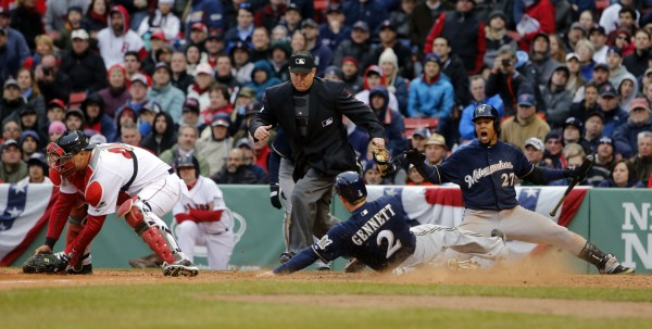 Milwaukee Brewers' Scooter Gennett scores a run past Boston Red Sox catcher A.J. Pierzynski in the ninth inning at Fenway Park in Boston Friday.