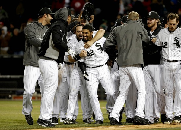 Chicago's Marcus Simien (center) celebrates with the team after defeating the Boston Red Sox at U.S Cellular Field in Chicago Tuesday night. The White Sox won 2-1.