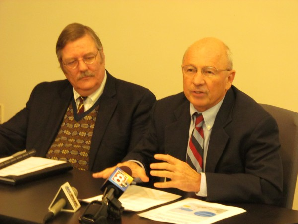 Portland Mayor Michael Brennan (right) discusses proposals to restructure the University of Southern Maine at a Wednesday afternoon news conference alongside Portland Regional Chamber of Commerce CEO Chris Hall.