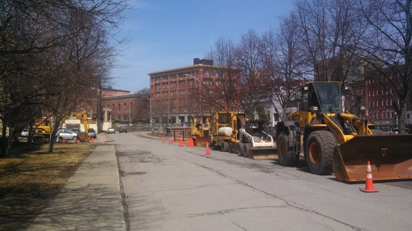 Construction equipment lined up along the Kenduskeag Stream in downtown Bangor. These machines will be used to dig up city streets, making way for new sewer and water lines to replace century-plus old infrastructure in the area. This is the first phase of the city's West Market Square revitalization.