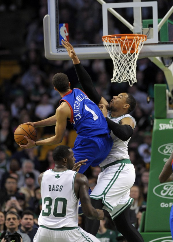 Philadelphia 76ers guard Michael Carter-Williams (1) drives to the basket while Boston Celtics center Jared Sullinger (7) defends during the second half at TD Garden in Boston Friday night.