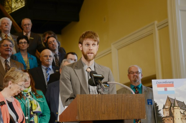 State Rep. Adam Goode, D-Bangor, speaks Wednesday during a press conference where Democrats were urging Republican Gov. Paul LePage to sign into law a bill that would help the state collect taxes from multinational corporations that shelter funds in accounts in foreign countries. Goode said the measure could bring in up to $10 million during the state's 2-year budget cycle.