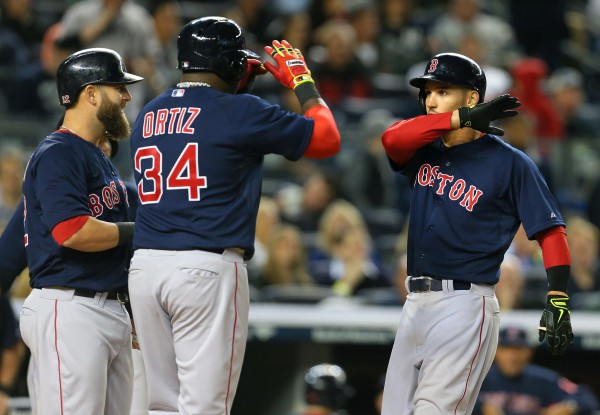 Boston's Grady Sizemore (38) celebrates his three-run home run with Red Sox designated hitter David Ortiz (34) and Mike Napoli (12) during the sixth inning at Yankee Stadium in New York Friday night.