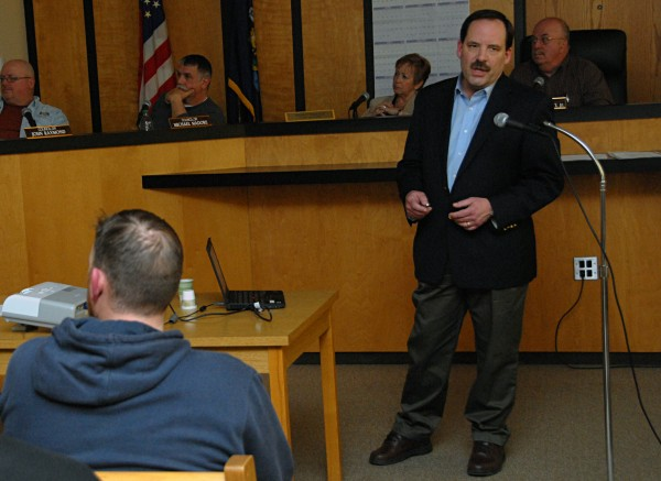 Cate Street Capital project manager Dammon M. Frecker speaks at a Millinocket Town Council meeting during his slideshow presentation on Thursday.