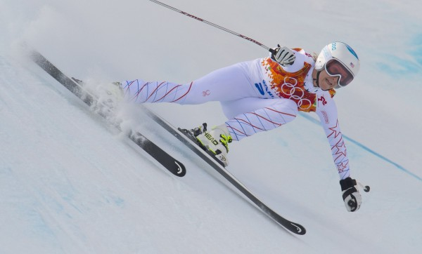 USA's Julia Mancuso on her way to a first place finish in the downhill portion of the Olympic women's super combined event Monday, Feb. 10, 2014, at the Winter Olympic Games in Sochi, Russia.