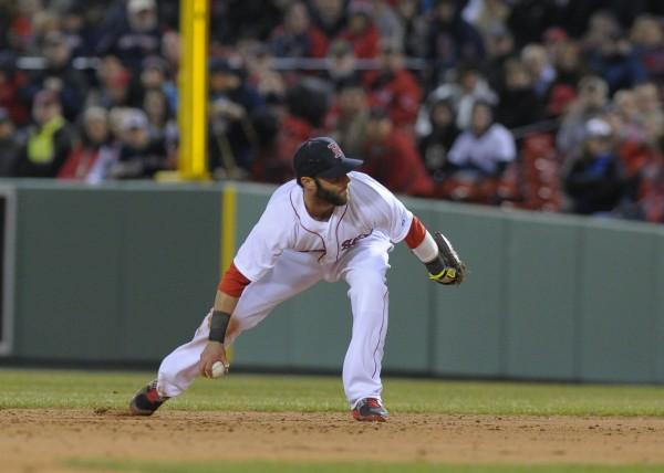 Boston Red Sox second baseman Dustin Pedroia (15) makes a throw to first base for an out during the fifth inning against the Texas Rangers at Fenway Park.