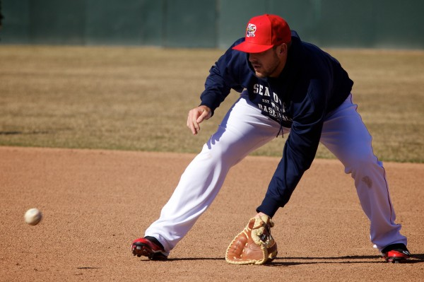 Portland Sea Dogs first baseman Travis Shaw snags a grounder during batting practice before the home opener in Portland on Thursday.