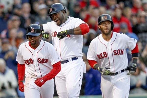 Boston Red Sox designated hitter David Ortiz (middle) pumps his chest after hitting a three-run homer during the eighth inning against of Wednesday's game against the Texas Rangers at Fenway Park in Boston. The Sox won 4-2.