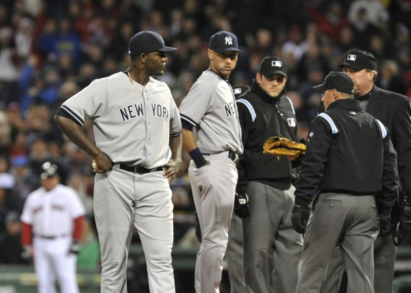 New York Yankees starting pitcher Michael Pineda (35) is ejected from the game for using a foreign substance during the second inning of Wednesday night's game against the Boston Red Sox at Fenway Park. The Red Sox won 5-1.