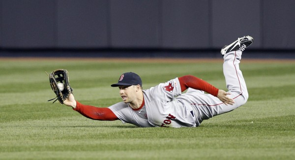 Boston Red Sox right fielder Daniel Nava (29) makes a diving catch for an out on a ball hit by Yangervis Solarte during the third inning at Yankee Stadium in New York Thursday night.