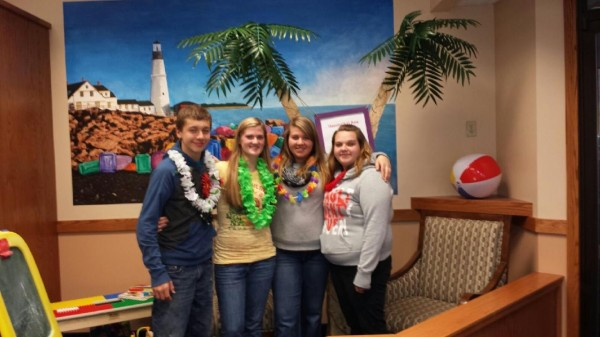 Joshua Martin (from left) is shown here with his sisters Danielle Partridge, Emily Martin and Kristina Martin at a send-off party at Day's Jewelers in Bangor celebrating his Make-A-Wish dream of going to Hawaii to learn how to surf.