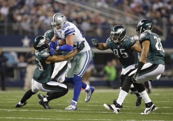 Dallas Cowboys tight end Jason Witten (82) is tackled by Philadelphia Eagles free safety Patrick Chung (23) and inside linebacker Mychal Kendricks (95) during the game at AT&T Stadium on Dec. 29, 2013.