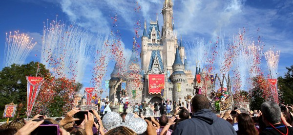 In this December 2012 file photo, fireworks and confetti fly over Cinderella Castle during the grand opening ceremony for the New Fantasyland at Walt Disney World's Magic Kingdom in Lake Buena Vista, Fla.