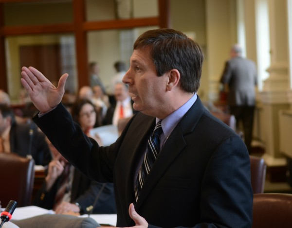 House Minority Leader Ken Fredette, R-Newport, gestures Tuesday evening during a debate in the House of Representatives regarding a bill that would prohibit the use of cash welfare benefits for tobacco, alcohol and other vice purchases. Fredette was urging his colleagues to reject the bill, as amended by the State Senate Monday, because the penalties in the bill were not strong enough, according to Republicans who have called the bill, &quota toothless tiger.&quot