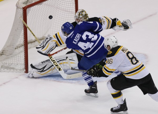 Toronto Maple Leafs forward Nazem Kadri (43) scores the game-winning goal on Boston Bruins goaltender Chad Johnson (30) as defenseman Kevan Miller (86) defends at the Air Canada Centre in Toronto Thursday night. Toronto defeated Boston 4-3 in overtime.