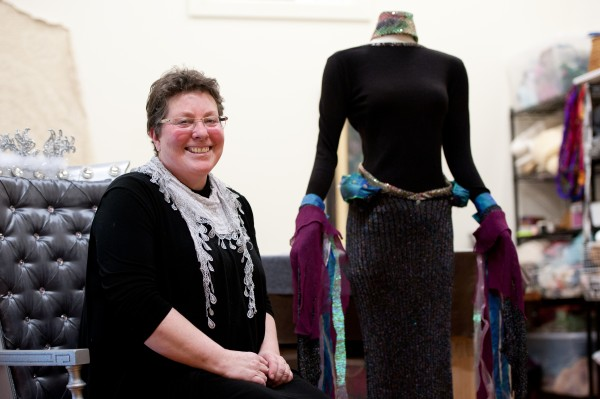 Beth Carr of Woolwich stands with her nearly finished design at her studio at the Fort Andross mill in Brunswick on March 27. Carr is creating a coastal look for the Altered Couture fashion show.