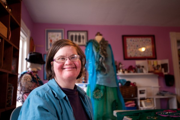 Anna McDougal of Wiscasset poses with her creation at Spindleworks in Brunswick on March 3. McDougal is creating the outfit for the Altered Couture fashion show on April 3 at the Fort Andross Gallery in Brunswick.