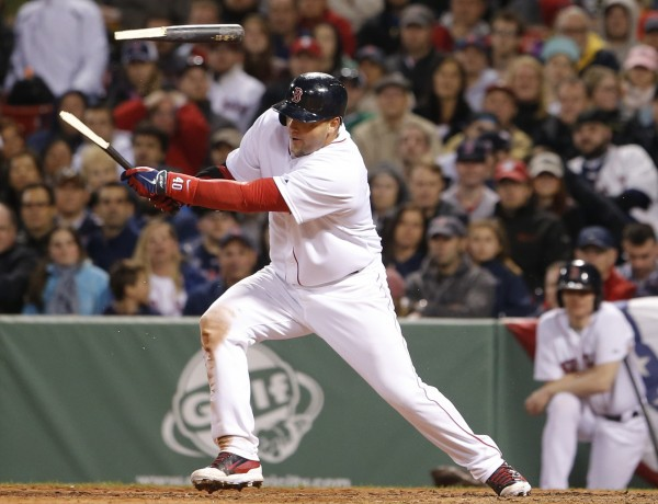 Boston Red Sox catcher A.J. Pierzynski breaks his bat on a hit driving in a run against the Texas Rangers in the seventh inning at Fenway Park in Boston Tuesday night.