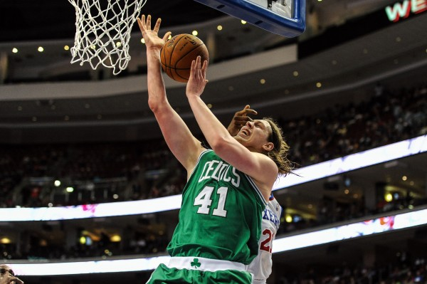 Boston Celtics center Kelly Olynyk takes a shot as Philadelphia 76ers forward Thaddeus Young defends during the second quarter of the game at the Wells Fargo Center in Philadelphia Monday night.