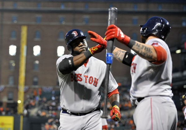 Boston Red Sox designated hitter David Ortiz (34) is congratulated by Jonny Gomes (5) after hitting a two-run home run in the third inning against the Baltimore Orioles at Oriole Park at Camden Yards in Baltimore Wednesday night.