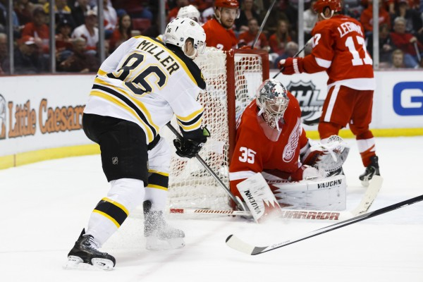 Detroit Red Wings goalie Jimmy Howard (35) makes a save on Boston Bruins defenseman Kevan Miller (86) in the second period at Joe Louis Arena in Detroit Wednesday night.