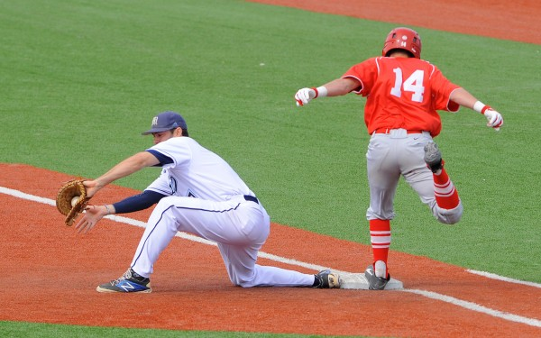 The University of Maine's Nick Bernardo (left) makes the catch as the University of Hartford's Adam Touhey gets to first base during a game at Mahaney Diamond in Orono on Monday afternoon.  Touhey was out on the play.
