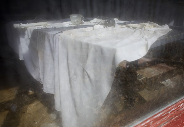 A table cloth lays over an old table inside the former Oronoka restaurant in Orono on Thursday.
