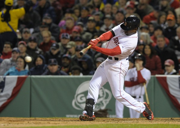 Boston's Jackie Bradley Jr. (25) hits an RBI single during the fourth inning against the Texas Rangers at Fenway Park in Boston Monday night.
