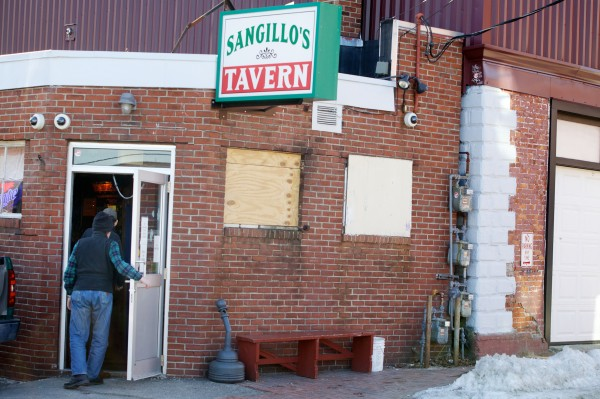 Patrons enter Sangillo's Tavern on Hampshire Street in Portland on Monday, March 17.
