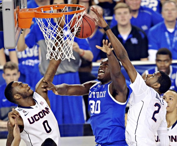 Connecticut's Phillip Nolan (0) and DeAndre Daniels (2) defend Kentucky's Julius Randle during the second half  in the NCAA championship game at AT&T Stadium in Arlington, Texas, Monday night.