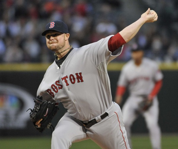 Jon Lester (31) of the Boston Red Sox delivers a pitch against the Chicago White Sox during Thursday night's game at U.S Cellular Field. Boston won 3-1.