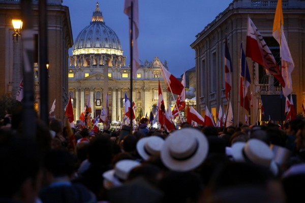 Polish pilgrims wait for mass before the canonisation ceremony in St. Peter's Square at the Vatican, April 27, 2014.