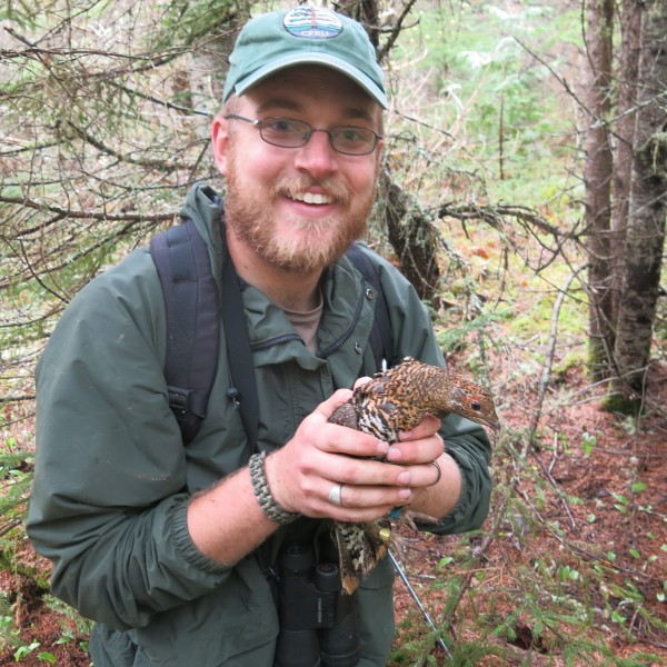 Researcher Steve Dunham with an American Spruce Grouse