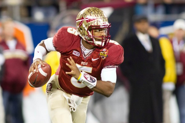 Florida State Seminoles quarterback Jameis Winston (5) runs the ball during the first quarter against the Duke Blue Devils at Bank of America Stadium on Dec. 7, 2013.