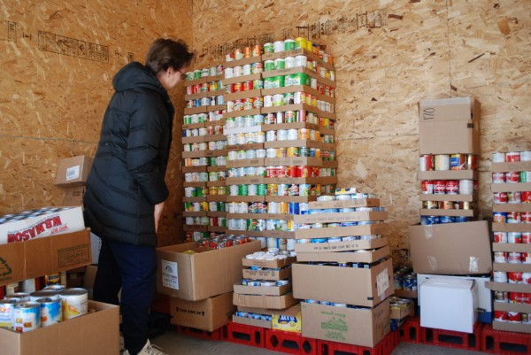 Marjorie Peronto of the University of Maine Cooperative Extension counts cans of food.