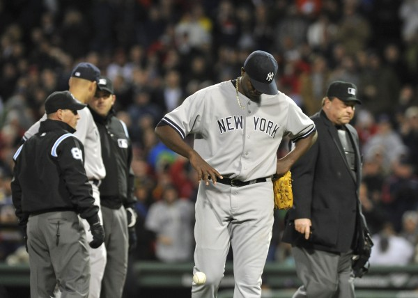 New York Yankees starting pitcher Michael Pineda (35) walks off the field after being ejected for having a foreign substance during the second inning against the Boston Red Sox at Fenway Park on Wednesday.