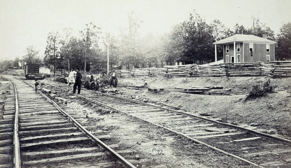 In April 1865, Timothy O'Sullivan photographed the train station and the South Side Railroad tracks at Appomattox Station, Va. The train wheels and axles stacked alongside the tracks likely belonged to the boxcars burned on April 8, 1865 by Union cavalrymen led by George Armstrong Custer.