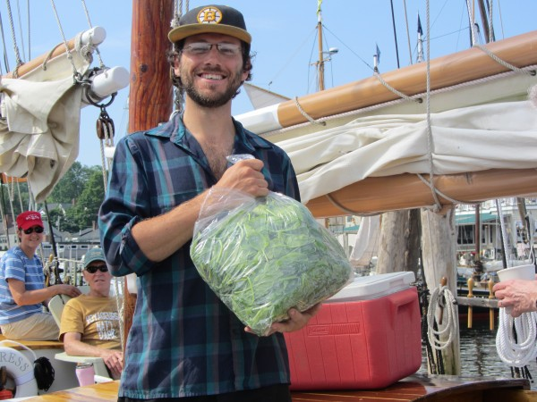 Bill Giordano, local-food coordinator for Maine Windjammer Cruises, arrives at the dock with fresh, locally grown spinach.