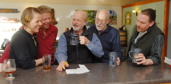 Working on the New York Times crossword puzzle causes the Mug Club members to share smiles and laughter at the Black Bear Brewery taproom in Orono. Tending to the puzzle on this day are (from left) Eliza Cronkite of Orono, Scott Johnson of Orono, Bob Seymour of Orono, Bill Unertl of Orono, and Skip Hawley of Old Town.
