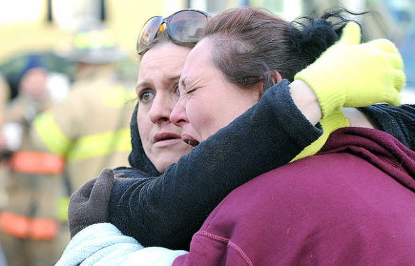 Kristie Graham (left) of Lewiston comforts her friend Shelly Brewer after a Lewiston firefighter told her &quoteverything is pretty much gone&quot in her 3rd floor apartment on Howe Street in Lewiston Thursday morning.  &quotAll I wanted was my mothers ashes.&quot Brewer said. This photo is courtesy of Russ Dillingham of the Sun Journal. To see more, visit sunjournal.com.