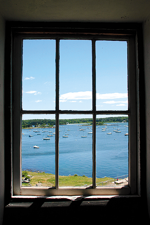 From inside the hexagonal blockhouse at Fort McClary State Historic Site in Kittery, the view extends across nearby Pepperell Cove and homes along the shore of Gerrish Island.