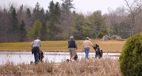 People enjoy a round of golf at the Hermon Meadow Golf Club Tuesday morning. John Snyer, the owner of the club, said that the greens held up well during the winter and the ground is drying up surprisingly fast.
