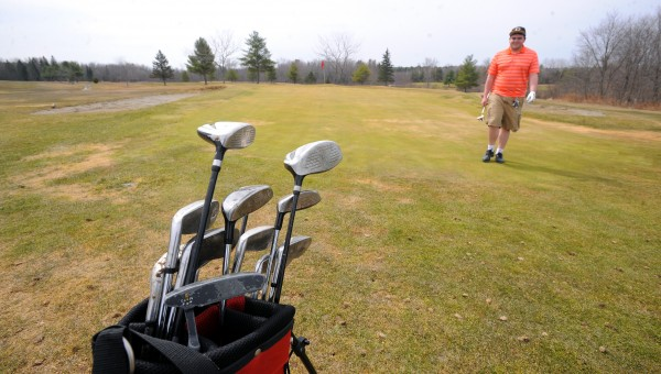 Ben Brown plays a round of golf at the Hermon Meadow Golf Club Tuesday morning.