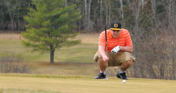 Ben Brown plays a round of golf at the Hermon Meadow Golf Club Tuesday morning. &quotI'm rusty, that's why I'm out here playing by myself,&quot Brown said after he teed off on the second hole.