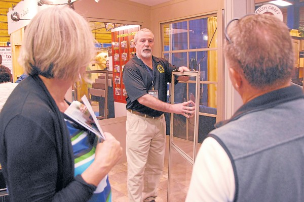 A home-improvement company representative discusses windows with visitors to the Bangor Home Show. This year's show will take place April 12-14 at the Cross Insurance Center in Bangor.