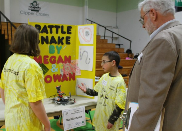 Youth explain their robotic project to one of the judges at the Washington County 4-H Robotics Expo.