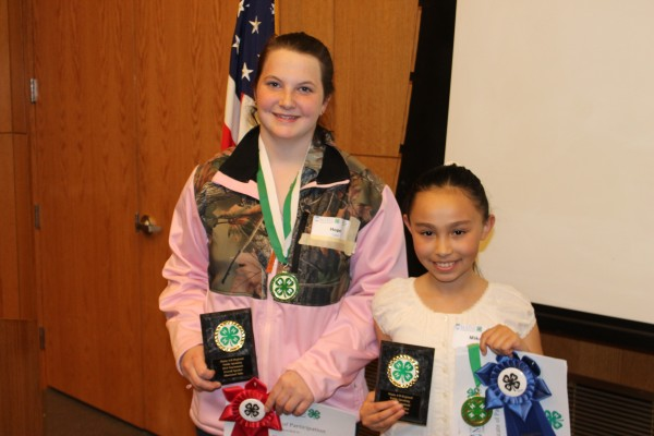4-H members display the awards they earned while participating at the Regional 4-H Public Speaking Tournament held at the University of Maine.