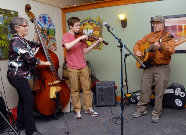 Maximum Blue plays bluegrass at the Black Bear Brewery taproom on March 21. Members of the band, which also plays swing and Celtic fiddle music, are (from left) Nancy Merrill on bass, Max Silverstein on fiddle, and Jeff Silverstein on guitar.
